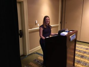 color photo of Tina Fletcher behind the podium